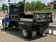 Rugby Contractor Dump Body offers independently operated double door sides with centrally located quick release levers and removable center post with single pin release system for quick removal.